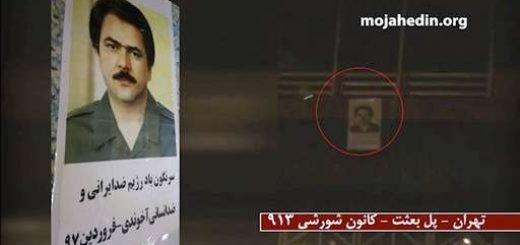 آویختن تصویر مسعود رجوی از پل بعثت تهران